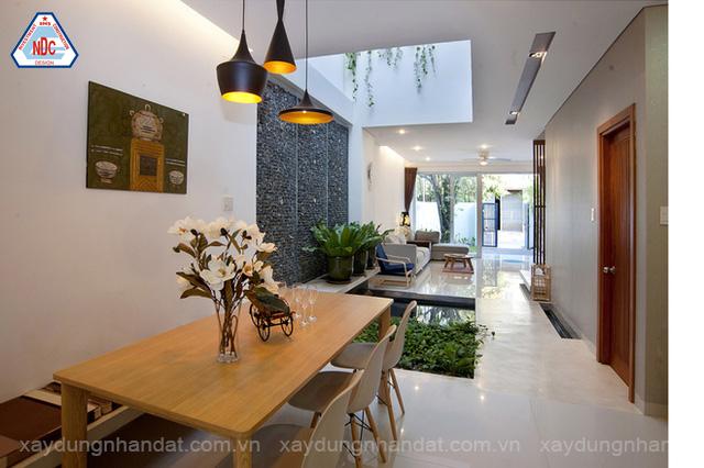 công ty thiết kế xây dựng nhà uy tín - không gian nội thất thông tầng, chiếu sáng thông gió tự nhiên